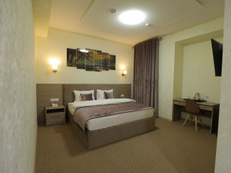 Level Business Hotel Tashkent - Image
